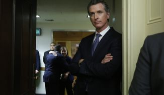 Governor-elect, Lt. Gov. Gavin Newsom, watches the Assembly session at the Capitol, Monday, Dec. 3, 2018, in Sacramento, Calif. All 80 members of the Assembly and half the 40 senators were sworn in Monday. (AP Photo/Rich Pedroncelli)
