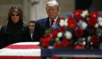 President Donald Trump and first lady Melania Trump pay their respects to former President George H. W. Bush, as he lies in state in the Rotunda of the U.S. Capitol, Monday, Dec. 3, 2018, in Washington. (AP Photo/Jacquelyn Martin) President Donald Trump and first lady Melania Trump greet the family of former President George H. W. Bush, Monday, Dec. 3, 2018, at the Blair House in Washington. Among the family are Bush' sons, former President George W. Bush and former Florida Gov. and 2016 GOP former presidential candidate Jeb Bush.  (AP Photo/Jacquelyn Martin)