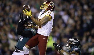 Washington Redskins' Michael Floyd (17) cannot hang onto a pass against Philadelphia Eagles' Corey Graham (24) and Tre Sullivan (37) during the first half of an NFL football game, Monday, Dec. 3, 2018, in Philadelphia. (AP Photo/Matt Rourke) ** FILE **