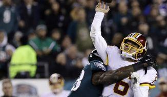 Washington Redskins' Mark Sanchez (6) is hit by Philadelphia Eagles' Nigel Bradham (53) during the first half of an NFL football game, Monday, Dec. 3, 2018, in Philadelphia. (AP Photo/Michael Perez)