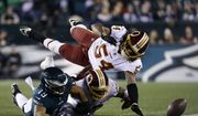 Philadelphia Eagles' Golden Tate, left, cannot hang onto a pass against Washington Redskins' Zach Brown, center, and Mason Foster during the first half of an NFL football game, Monday, Dec. 3, 2018, in Philadelphia. (AP Photo/Michael Perez) **FILE**