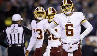 Washington Redskins' Mark Sanchez reacts during the second half of an NFL football game against the Philadelphia Eagles, Monday, Dec. 3, 2018, in Philadelphia. (AP Photo/Matt Rourke)