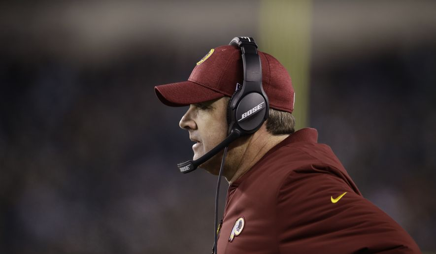 Washington Redskins head coach Jay Gruden looks on from the sidelines during the second half of an NFL football game against the Philadelphia Eagles, Monday, Dec. 3, 2018, in Philadelphia. (AP Photo/Matt Rourke) ** FILE **
