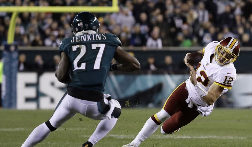 Washington Redskins' Colt McCoy (12) tries to avoid Philadelphia Eagles' Malcolm Jenkins (27) during the first half of an NFL football game, Monday, Dec. 3, 2018, in Philadelphia. (AP Photo/Michael Perez)