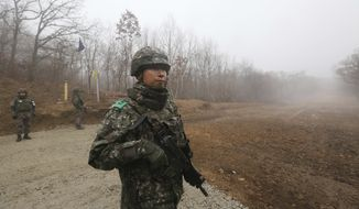 "South Korean army soldiers stand guard inside the Demilitarized Zone (DMZ) in the central section of the inter-Korean border in Cheorwon, South Korea, Monday, Dec. 3, 2018. South Korea's president says U.S. President Donald Trump told him he has a ""very friendly view"" of North Korean leader Kim Jong Un and wants to grant his wishes if he denuclearizes.(AP Photo/Ahn Young-joon)"