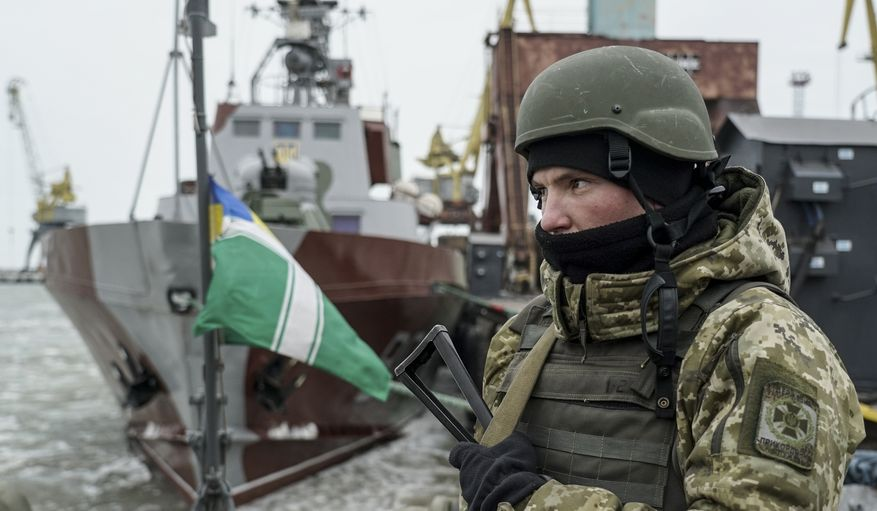 A Ukrainian serviceman stands on board a coast guard ship in the Sea of Azov port of Mariupol, eastern Ukraine, Monday, Dec. 3, 2018. The Ukrainian military has been on increased readiness as part of martial law introduced in the country in the wake of the Nov. 25, 2018 incident in the Sea of Azov, in which the Russian coast guard fired upon and seized three Ukrainian navy vessels along with their crews. (AP Photo/Evgeniy Maloletka)