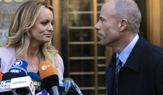 Adult film actress Stormy Daniels, left, stands with her lawyer, Michael Avenatti, after speaking outside federal court in New York on April 16, 2018. (AP Photo/Mary Altaffer)
