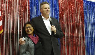 FILE - In this Nov. 4, 2018 file photo, Alaska Republican gubernatorial candidate Mike Dunleavy stands with his wife, Rose, on stage during a GOP rally in Anchorage, Alaska. Alaska Gov.-elect Mike Dunleavy takes office Monday, Dec. 3, days after a magnitude 7.0 earthquake rocked heavily-populated south-central Alaska.  (AP Photo/Becky Bohrer, File)