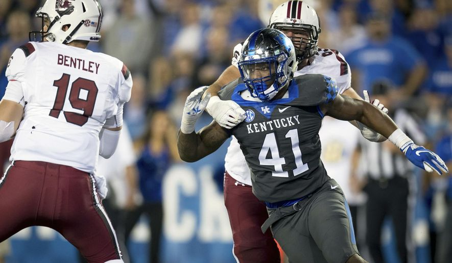 FILE - In this Sept. 29, 2018, file photo, Kentucky linebacker Josh Allen (41) rushes South Carolina quarterback Jake Bentley (19) during the second half of an NCAA college football game in Lexington, Ky. Allen is the defensive player of the year on The Associated Press All-Southeastern Conference team, announced Monday, Dec. 3, 2018. (AP Photo/Bryan Woolston, File)