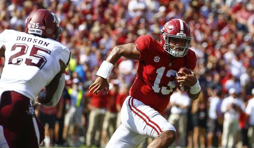 FILE - In this Sept. 22, 2018, file photo, Alabama quarterback Tua Tagovailoa (13) scrambles for a first down against Texas A&M during the first half of an NCAA college football game, in Tuscaloosa, Ala.  Tagovailoa is the offensive player of the year and one of five members of the top-ranked Crimson Tide to earn first-team honors on The Associated Press All-Southeastern Conference team, announced Monday, Dec. 3, 2018. (AP Photo/Butch Dill, File) **FILE**