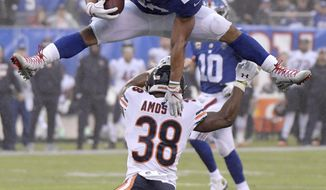 New York Giants running back Saquon Barkley (26) leaps over Chicago Bears strong safety Adrian Amos (38) during the second half of an NFL football game, Sunday, Dec. 2, 2018, in East Rutherford, N.J. (AP Photo/Bill Kostroun)