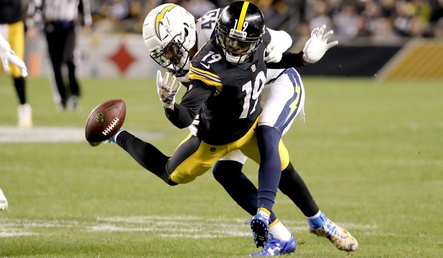 Los Angeles Chargers cornerback Michael Davis (43) is called for pass interference on Pittsburgh Steelers wide receiver JuJu Smith-Schuster (19) in the first half of an NFL football game, Sunday, Dec. 2, 2018, in Pittsburgh. The Chargers won 33-30. (AP Photo/Gene J. Puskar)