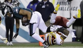 Philadelphia Eagles' Golden Tate (19) is tackled by Washington Redskins' Ha Ha Clinton-Dix (20) during the second half of an NFL football game, Monday, Dec. 3, 2018, in Philadelphia. (AP Photo/Michael Perez)