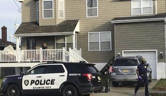 FBI agents search the home of Mayor Frank Gilliam Jr., Monday, Dec. 3, 2018, in Atlantic City, N.J. The FBI's Newark division confirms agents are at Gilliam's house Monday executing a search warrant. It wasn't immediately known what prompted the search. (Colt Shaw/The Press of Atlantic City via AP)