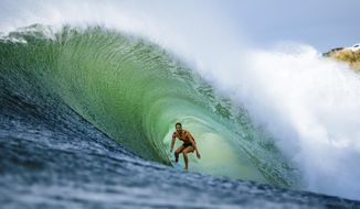In this 2018 photo, Stephanie Gilmore of Australia competes at the Beachwaver Maui Pro, in Honolua, Hawaii. If Gilmore wins the gold medal when surfing makes its Olympic debut next year, it might be considered a very nice bonus. Now in the conversation as the greatest of all time on the women's side in her sport, Gilmore successfully fought for another prize, equal pay for the women, on the professional tour where she and the rest of her rivals make their living. (Ed Sloane/World Surf League via AP)