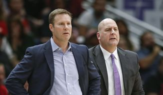 FILE - In this Oct. 21, 2017, file photo, Chicago Bulls head coach Fred Hoiberg, left, and his assistant Jim Boylen, right, look on from the sidelines during the first half of an NBA basketball game against the San Antonio Spurs, in Chicago. The Bulls fired Hoiberg Monday, Dec. 3, 2018. (AP Photo/Kamil Krzaczynski, File) **FILE**