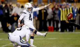 Los Angeles Chargers kicker Mike Badgley (4) hits a field goal from the hold by Donnie Jones to defeat the Pittsburgh Steelers 33-30 with no time left in an NFL football game, Sunday, Dec. 2, 2018, in Pittsburgh. (AP Photo/Don Wright)