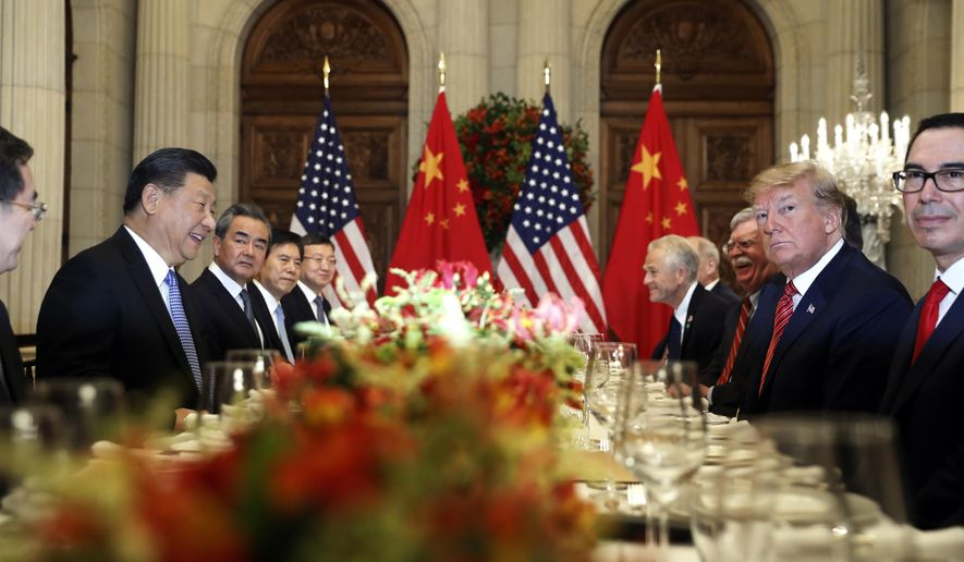 FILE - In this Dec. 1, 2018, file photo, U.S. President Donald Trump, second right, and China's President Xi Jinping, second left, attend their bilateral meeting at the G20 Summit in Buenos Aires, Argentina. A U.S.-Chinese cease fire on tariffs gives jittery companies a respite but does little to resolve a war over Beijing's technology ambitions that threatens to chill global economic growth. (AP Photo/Pablo Martinez Monsivais, File)  **FILE**