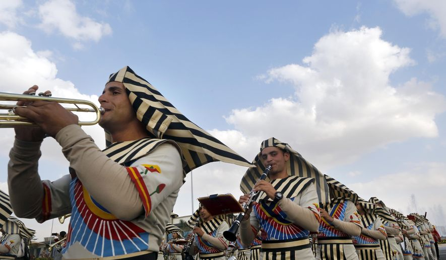 Members of an Army band wear Pharaonic costumes during the opening of the first arms fair organized in Cairo, Egypt, Monday, Dec. 3, 2018. Egypt's President Abdel Fattah al-Sisi inaugurated the fair, where hundreds of companies are participating.(AP Photo/Amr Nabil)