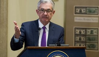 FILE - In a Thursday, Nov. 29, 2018 file photo, Federal Reserve Chairman Jerome Powell addresses the Federal Reserve Board's 15th annual College Fed Challenge Finals in Washington. Powell said Monday, Dec. 3, 2018 that Powell says that despite solid economic progress, the country still faces a number of challenges including slow wage-growth for lower-income workers to sluggish productivity and an aging population.  (AP Photo/Cliff Owen, File)