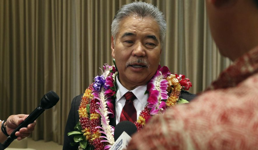 Hawaii Gov. David Ige speaks to reporters at the Hawaii State Capitol in Honolulu on Monday, Dec. 3, 2018. Ige has taken the oath of office for a second term as Hawaii's governor. (AP Photo/Audrey McAvoy)