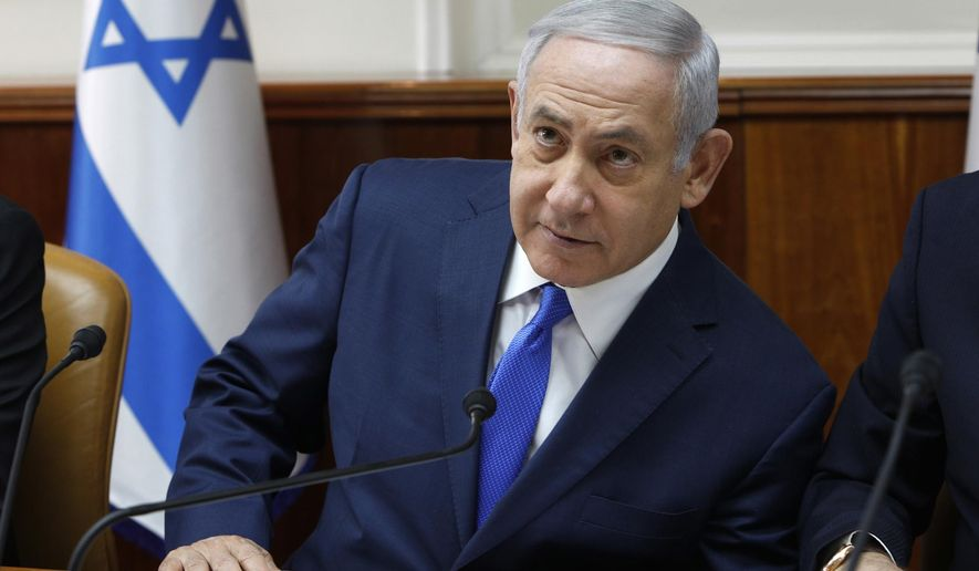 Israeli Prime Minister Benjamin Netanyahu attends the weekly cabinet meeting at his office in Jerusalem, Sunday Dec. 2, 2018.  Israeli police on Sunday recommended indicting Prime Minister Netanyahu on bribery charge allegations related to a corruption case involving Israel's Bezeq telecom giant. (Gali Tibbon/Pool via AP)