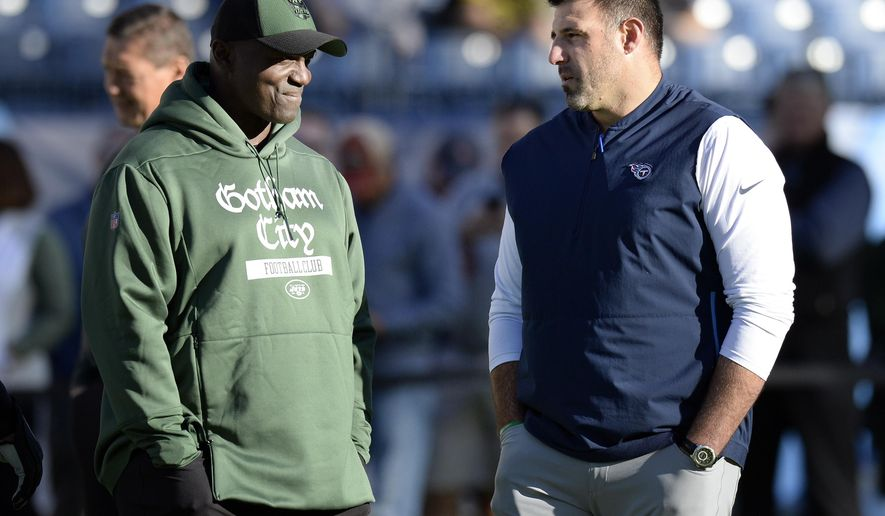 New York Jets head coach Todd Bowles, left, and Tennessee Titans head coach Mike Vrabel talk before an NFL football game Sunday, Dec. 2, 2018, in Nashville, Tenn. (AP Photo/Mark Zaleski)