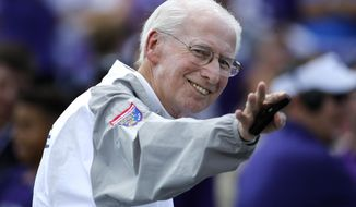 FILE - In this Sept. 1, 2018, file photo, Kansas State head coach Bill Snyder wave at fans before an NCAA college football game against South Dakota, in Manhattan, Kan. Kansas State has gone through the unenviable process of replacing a legend once before, and results were so disappointing that Bill Snyder came out of retirement to put the program back on track. Now, the Wildcats get a do-over. The 79-year-old Snyder announced in a statement Sunday, Dec. 2, 2018, he was retiring for a second and final time as the coach at Kansas State.(AP Photo/Charlie Riedel, File)