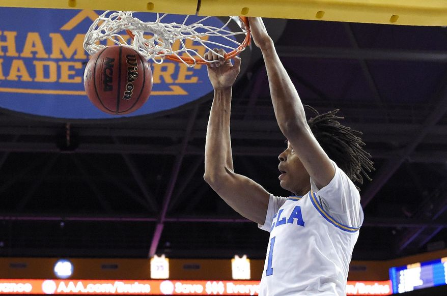 UCLA center Moses Brown dunks during the first half of an NCAA college basketball game against Loyola Marymount Sunday, Dec. 2, 2018, in Los Angeles. (AP Photo/Mark J. Terrill)