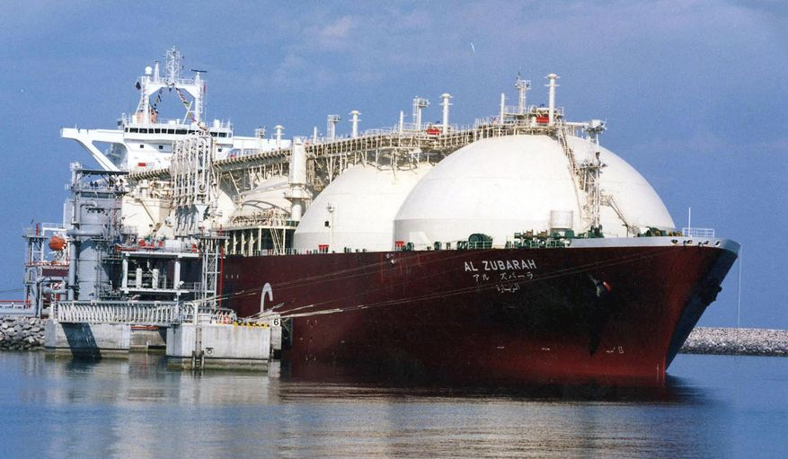 This undated file photo shows a Qatari liquid natural gas (LNG) tanker ship being loaded up with LNG at Raslaffans Sea Port, northern Qatar. The tiny, energy-rich Arab nation of Qatar announced on Monday, Dec. 3, 2018 it would withdraw from OPEC, mixing its aspirations to increase production outside of the cartel's constraints with the politics of slighting the Saudi-dominated group amid the kingdom's boycott of Doha. (AP Photo, File)