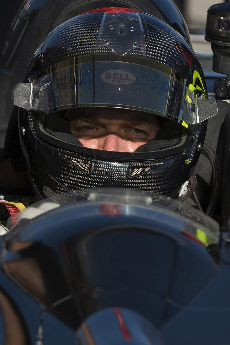 FILE- In this March 19, 2010, file photo, Level 5 Motorsports driver Scott Tucker waits during a break in a practice session for the American Le Mans Series' 12 Hours of Sebring auto race in Sebring, Fla. A U.S. appeals court has upheld a nearly $1.3 billion award against a pro racecar driver who ran a payday loan business accused by federal authorities of deceiving consumers. A unanimous three-judge panel of the 9th U.S. Circuit Court of Appeals ruled Monday, Dec. 3, 2018, that information Scott Tucker provided consumers did not accurately disclose the terms of the loans. The appeals panel also said a lower court did not abuse its authority when it ordered Tucker and other defendants to pay back nearly $1.3 billion. (AP Photo/Steve Nesius, File)
