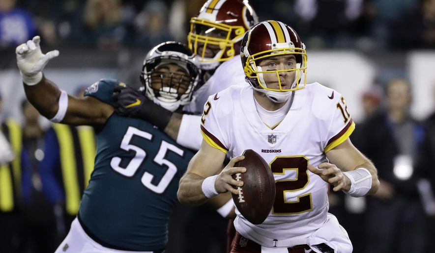 Washington Redskins quarterback Colt McCoy looks for a pass during the first half of an NFL football game against the Philadelphia Eagles, Monday, Dec. 3, 2018, in Philadelphia. (AP Photo/Michael Perez)