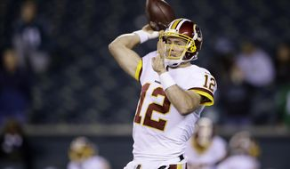 Washington Redskins' Colt McCoy warms up before an NFL football game against the Philadelphia Eagles, Monday, Dec. 3, 2018, in Philadelphia. (AP Photo/Matt Rourke) ** FILE **