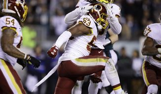 Washington Redskins' Zach Brown (53) is congratulated by teammates after making a tackle on fourth down during the first half of an NFL football game against the Philadelphia Eagles, Monday, Dec. 3, 2018, in Philadelphia. (AP Photo/Matt Rourke) ** FILE **