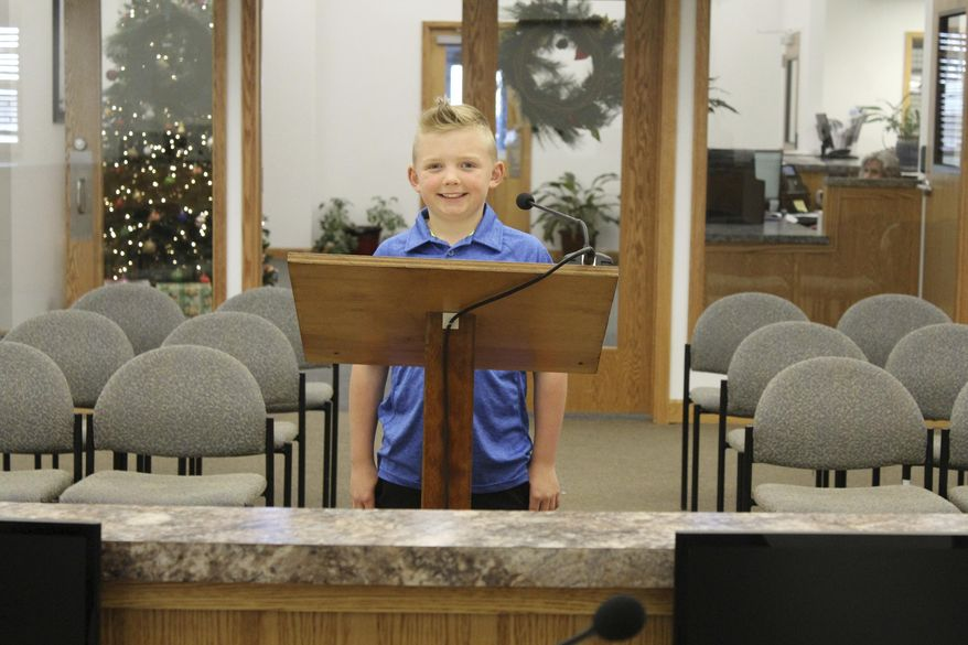 In this Thursday, Nov. 29, 2018, photograph, 9-year-old Dane Best poses in the council chambers in Severance, Colo. Dane is trying to get rid of his town's ban on snowballs and officials are wondering what took so long. (Sara Knuth/Greeley Tribune via AP)