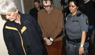 FILE - In this Monday, Nov. 12, 2018 file photo, Jean-Claude Arnault, center, is escorted from court after the first day of his appeal trial, in Stockholm. The man with ties to the Swedish Academy that awards the literature Nobel Prize has lost his appeal to have his rape conviction and a two-year prison sentence reversed and been convicted of a second rape. The Svea Court of Appeal on Monday Dec. 3, 2018, gave Jean-Claude Arnault 2.5 years in jail for raping the same woman twice seven years ago. (Jonas Ekstromer/TT News Agency via AP, File)