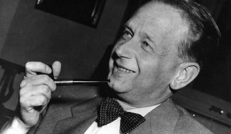 FILE - In this May 19, 1953, file photo, Dag Hammarskjold, recently appointed secretary general of the United Nations who is on a visit to Sweden, smokes his pipe at a press conference held at the Foreign Office in Stockholm. The U.N. legal chief says new information has been received that could shed light on the mysterious 1961 plane crash that killed Hammarskjold on a peace mission to newly independent Congo. Miguel de Serpa Soares told the U.N. General Assembly on Monday, Dec, 3, 2018, that the information comes from intelligence, security and defense archives and other sources. (AP Photo, File)