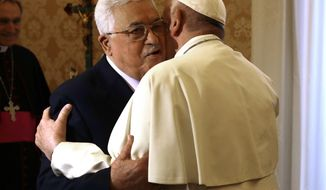 Pope Francis, right, welcomes Palestinian President Mahmoud Abbas during a private audience at the Vatican, Monday Dec. 3, 2018. (AP Photo/Andrew Medichini, Pool)