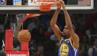 Golden State Warriors forward Kevin Durant (35) scores during the first half of an NBA basketball game against the Atlanta Hawks Monday, Dec. 3, 2018, in Atlanta. (AP Photo/John Bazemore)