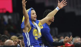 Golden State Warriors guard Stephen Curry (30) reacts from the sideline during the first half of an NBA basketball game Monday, Dec. 3, 2018, in Atlanta. Golden State won 128-111. (AP Photo/John Bazemore)