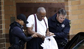 Bill Cosby is escorted out of the Montgomery County Correctional Facility in Eagleville, Pa., on Sept. 25, 2018, following his sentencing to a three- to-10-year prison sentence for sexual assault. (AP Photo/Jacqueline Larma) ** FILE **