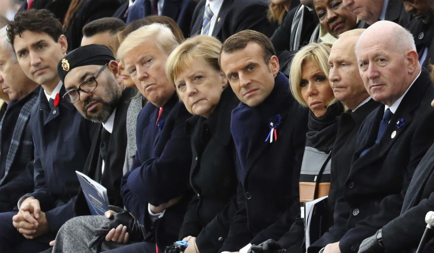 World leaders, from left, Canadian Prime Minister Justin Trudeau, Morocco's Prince Moulay Hassan, Moroccan King Mohammed VI, U.S. first lady Melania Trump, U.S. President Donald Trump, German Chancellor Angela Merkel, French President Emmanuel Macron and his wife Brigitte Macron, Russian President Vladimir Putin and Australian Governor-General Peter Cosgrove attend a ceremony at the Arc de Triomphe in Paris as part of the commemorations marking the 100th anniversary of the Nov. 11, 1918, armistice, which ended World War I, on Sunday, Nov. 11, 2018. (Ludovic Marin/Pool Photo via AP)  **FILE**