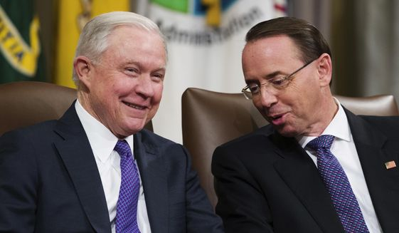Then-Attorney General Jeff Sessions, left, and Deputy Attorney General Rod Rosenstein, talk during an event to announce new strategic actions to combat the opioid crisis at the Department of Justice's National Opioid Summit in Washington on Oct. 25, 2018. (AP Photo/Alex Brandon) ** FILE **