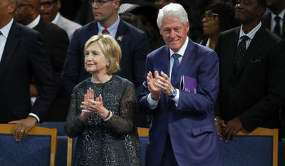"""Tickets to see """"An Evening With the Clintons"""" and hear them blab about their lives are selling for the cost of a Big Mac Meal at McDonald's. (Associated Press file photograph)"""