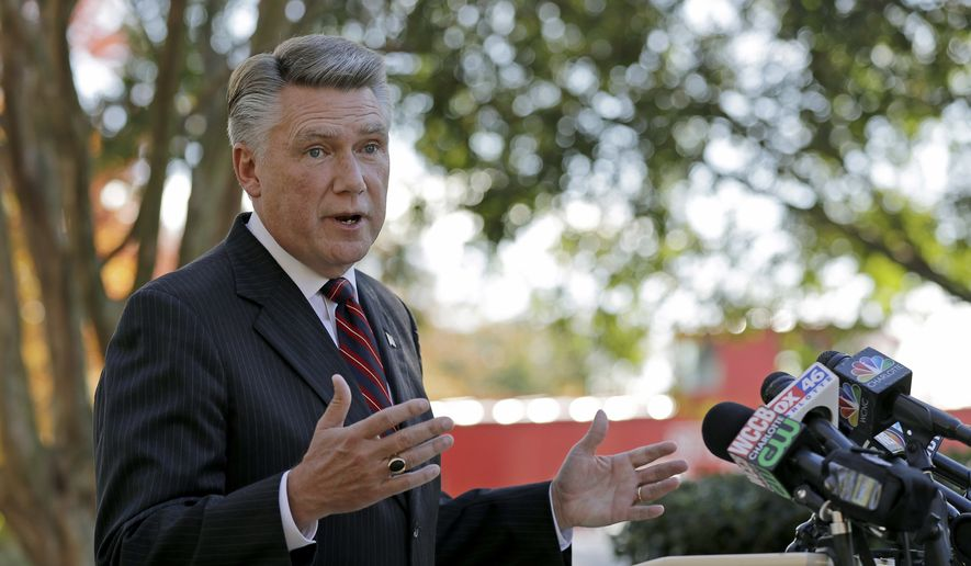 Mark Harris speaks to the media during a news conference in Matthews, N.C., Wednesday, Nov. 7, 2018. Harris is leading Dan McCready for the 9th Congressional District in a race that is still too close to call. (AP Photo/Chuck Burton)
