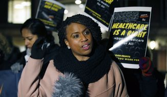 Rep.-elect Ayanna Pressley, D-Mass. speaks at a small rally outside an orientation meeting for incoming members of Congress at Harvard University in Cambridge, Mass., Tuesday, Dec. 4, 2018. (AP Photo/Michael Dwyer)