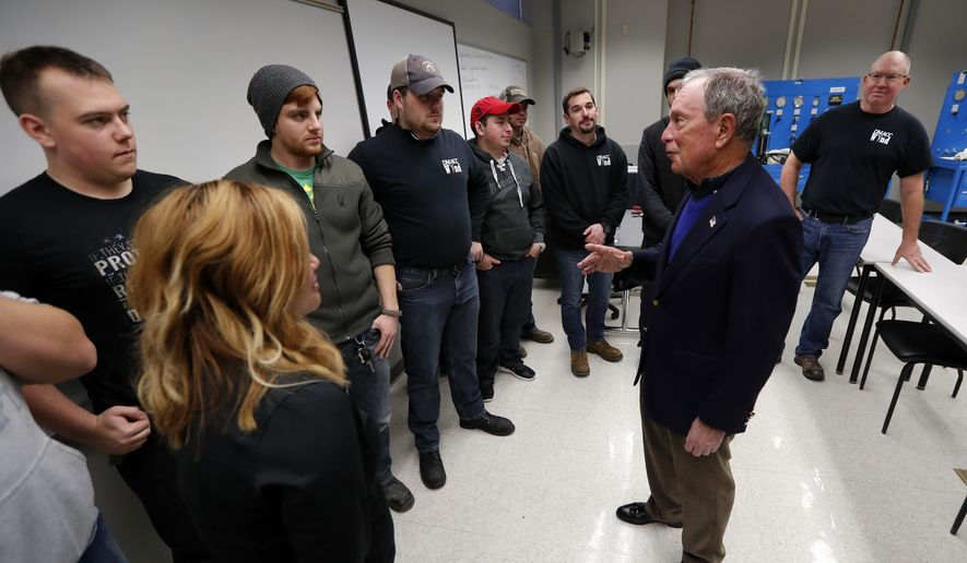 Former New York City Mayor Michael Bloomberg, right, talks with students in the Wind Technology program at Des Moines Area Community College, Tuesday, Dec. 4, 2018, in Ankeny, Iowa. (AP Photo/Charlie Neibergall) **FILE**
