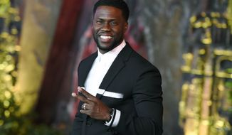 """Kevin Hart arrives at the Los Angeles premiere of """"Jumanji: Welcome to the Jungle"""" in Los Angeles. Hart will host the 2019 Academy Awards, fulfilling a lifelong dream for the actor-comedian. Hart announced Tuesday, Dec. 4, 2018, his selection in an Instagram statement and the Academy of Motion Picture Arts and Sciences followed up with a tweet that welcomed him """"to the family."""" (Photo by Jordan Strauss/Invision/AP, File)"""