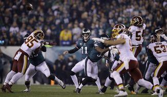 Philadelphia Eagles quarterback Carson Wentz (11) in action during an NFL football game against the Washington Redskins, Monday, Dec. 3, 2018, Philadelphia. (AP Photo/Matt Rourke)