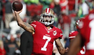 """FILE - In this Jan. 1, 2017 file photo, San Francisco 49ers quarterback Colin Kaepernick (7) warms up before an NFL football game against the Seattle Seahawks in Santa Clara, Calif. Washington Redskins coach Jay Gruden says the team """"talked about and discussed"""" bringing in Kaepernick for a tryout """"but we will probably go in a different direction."""" Gruden told reporters during a conference call Tuesday, Dec. 4, 2018 that would there have been """"a greater possibility"""" of considering Kaepernick if the Redskins were in need of a QB in Week 1 rather than at this stage of the season now. (AP Photo/Tony Avelar, File)"""